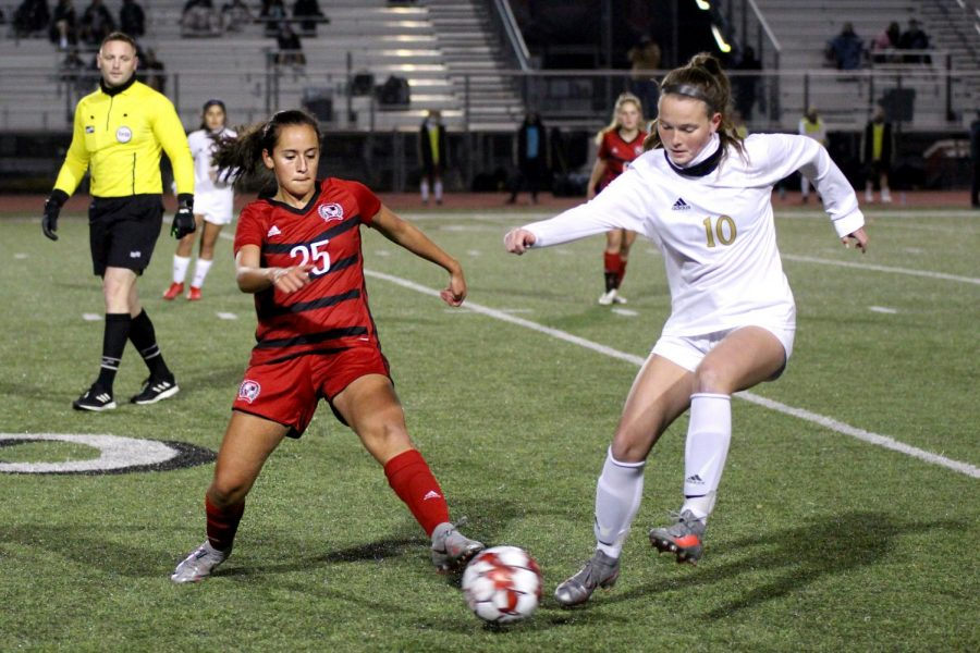 Sophomore holding mid no. 25 Natalia Duran de La Vega goes in for a tackle with sophomore midfielder no. 10 Kristen Sueltz. The Colony only scored three penalty kicks in the overtime.
