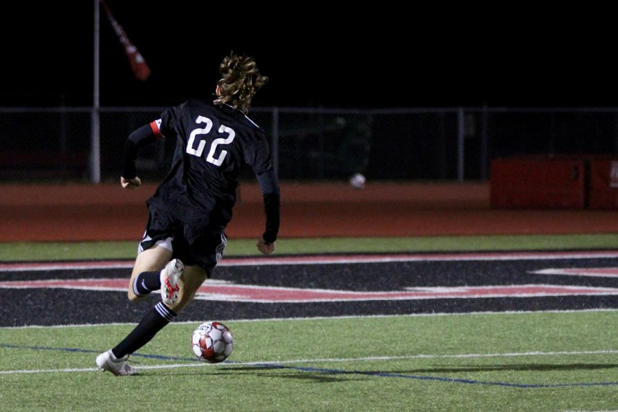 Senior forward no. 22 Cade Novicke dribbles the ball. Novicke attempted to score during this run but was stopped by Wylie East's goalkeeper senior no. 1 Jason Pierce.