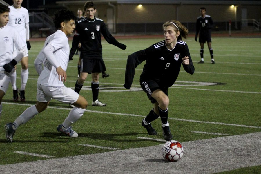 Senior defender no. 9 Luke Hopkinson dribbles the ball around a Wylie East player. The Leopards have now played two district games for the season.