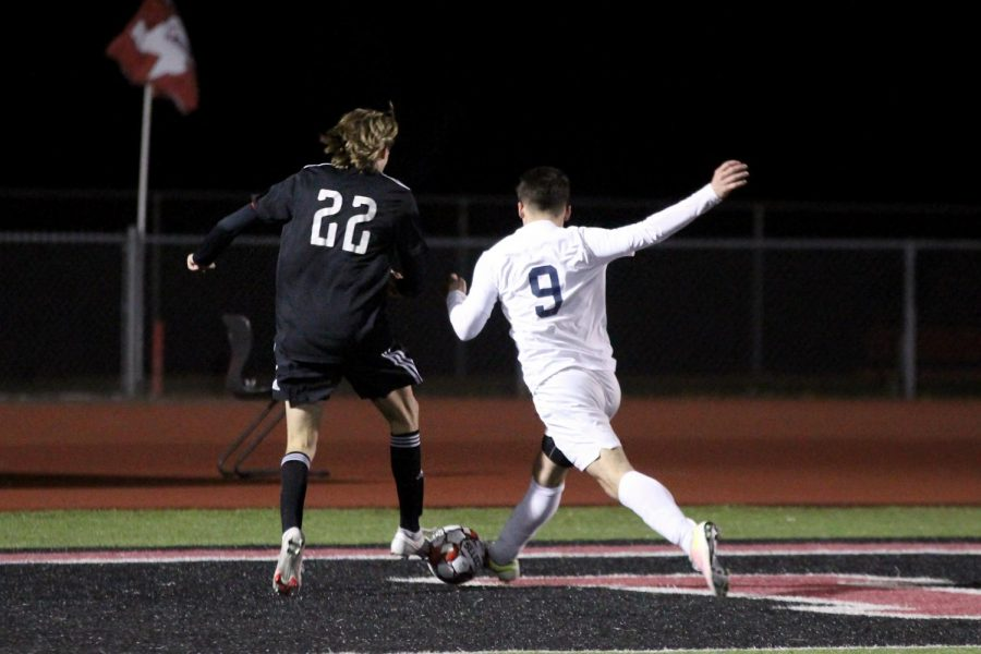 Senior forward no. 22 Cade Novicke fights for the ball with a Wylie East defender. Novicke assisted senior forward no. 3 Michael Myers goal.