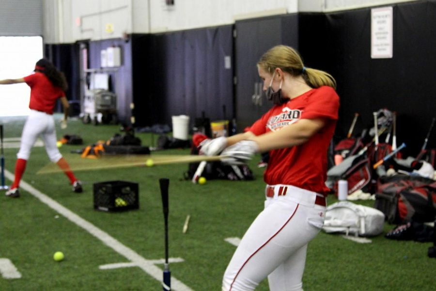Freshmen Alyssa Morely practices batting in the indoor facility. The softball team will play Sachse and Rains on Jan. 30 in Little Elm.