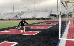 Freshmen Taylor Person kicks the ball into goal. Person also plays for the FC Dallas ECNL team.