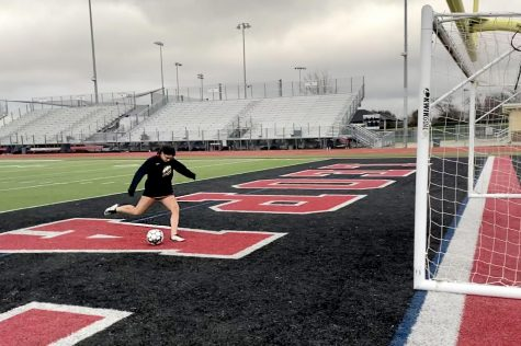 Freshmen Taylor Person kicks the ball into goal. Person also plays for the FC Dallas ECNL team.