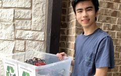 Senior Zachary Nakamura holds the eyeglasses he has collected. Nakamura collected the glasses for Allen Eye Associates.