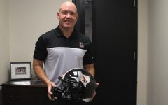 Chris Ross is the head  coach of the football team. Ross received the 5A coach of the year award.