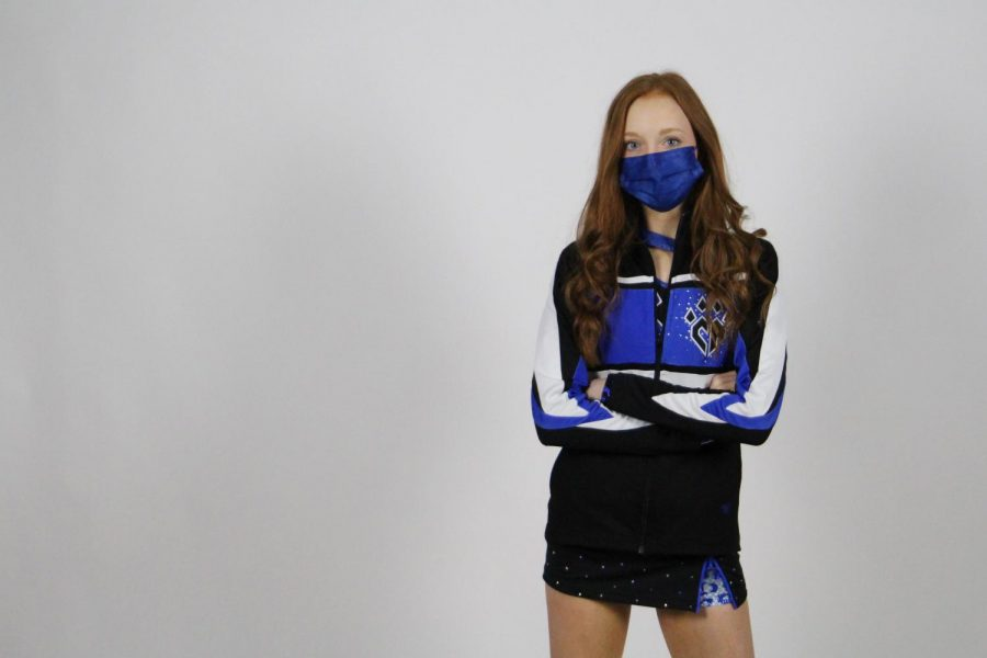 Junior Claire Traylor cheers on Swooshcats at Cheer Athletics. Traylor has been on her current team for 3 years.