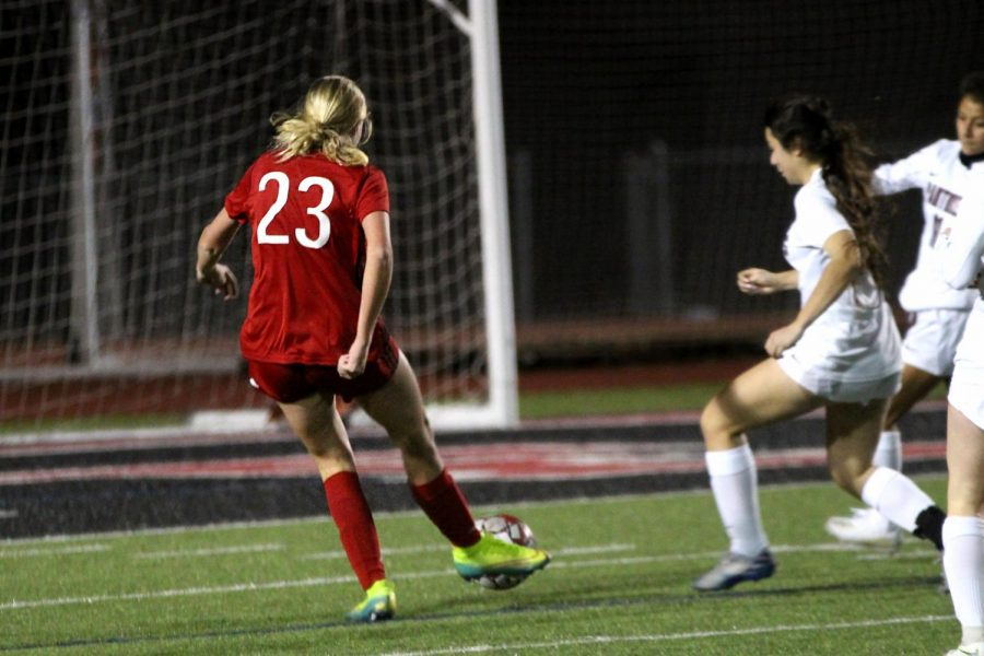 Junior outside defender no. 23 Avery Templin attempts to score a goal. Templin's attempt was blocked by Princeton's no. 0 Charlee Proctor.