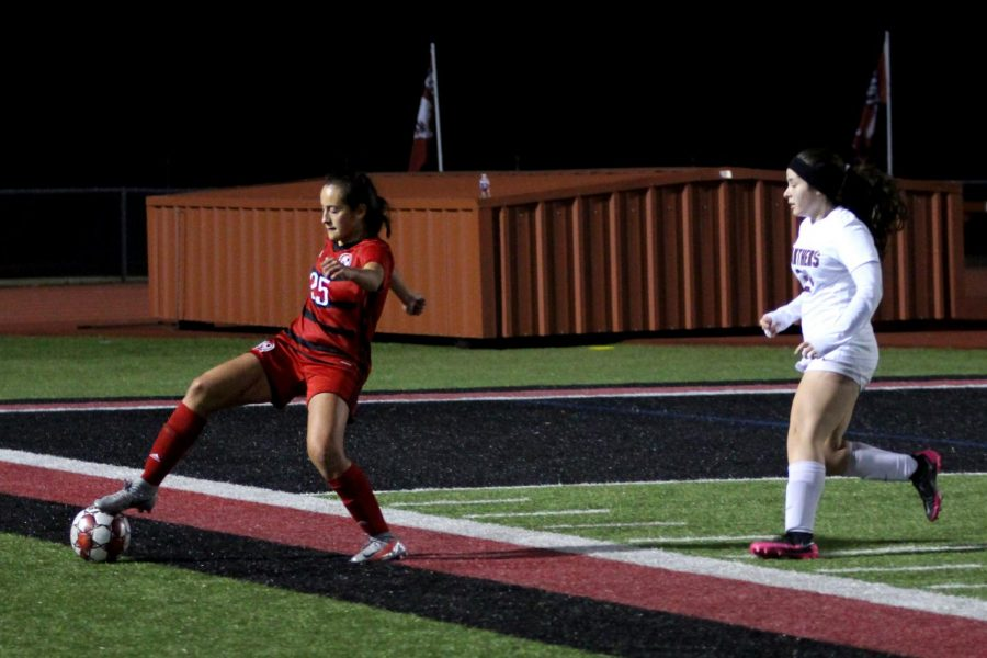 Sophomore holding mid no. 25 Natalia Duran de La Vega gets the ball before it goes out of bounds. Duran de La Vega started this game as a midfielder.