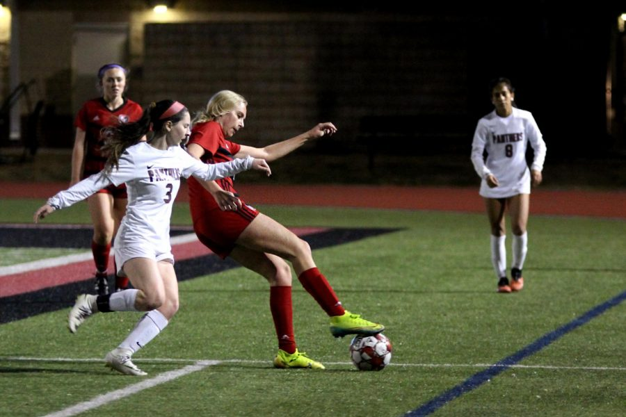 Junior defender no. 23 Avery Templin moves the ball around no. 3 Naomi English. The Leopards won the game with a final score of 2-0.