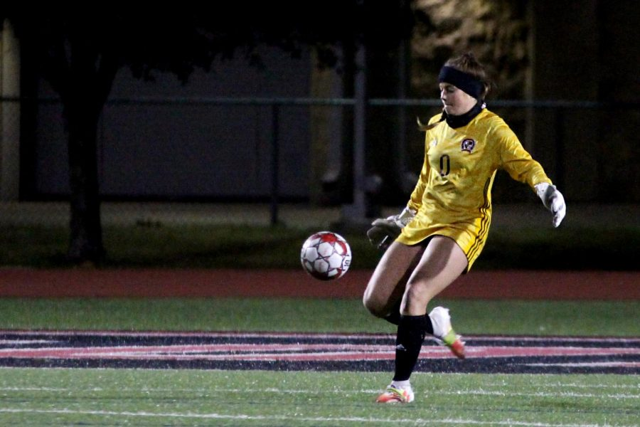 Senior goalkeeper no. 0 Hailey Downing kicks the ball out of the box. Downing started as the goalkeeper for this game.
