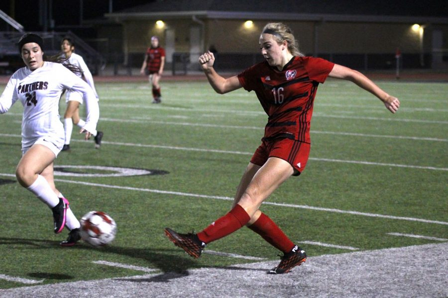 Sophomore left outside defender no. 16 Emmy Wood kicks the ball past Princeton's Justice Peinado. The girls soccer team will play their next game against the Wylie East Raiders tonight.