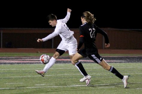 Senior forward no. 22 Cade Novicke runs to get the ball from a Wylie East defender. The soccer team will play Rock Hill on Friday night away.