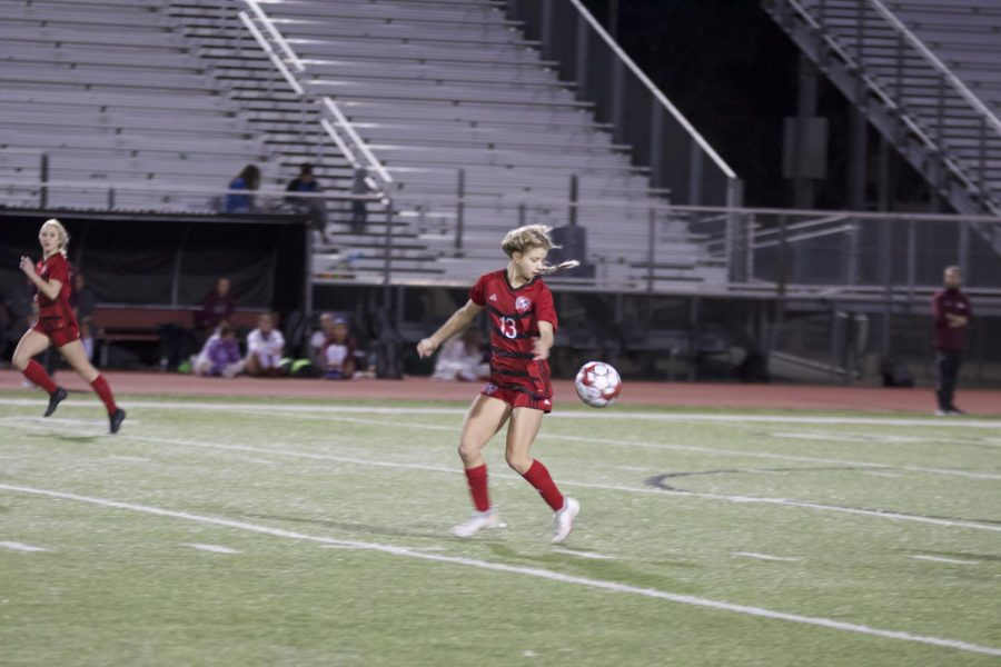 Senior forward no. 11 Hannah Dunlap moves the ball down the field. Dunlap  scored the fourth goal of the game.
