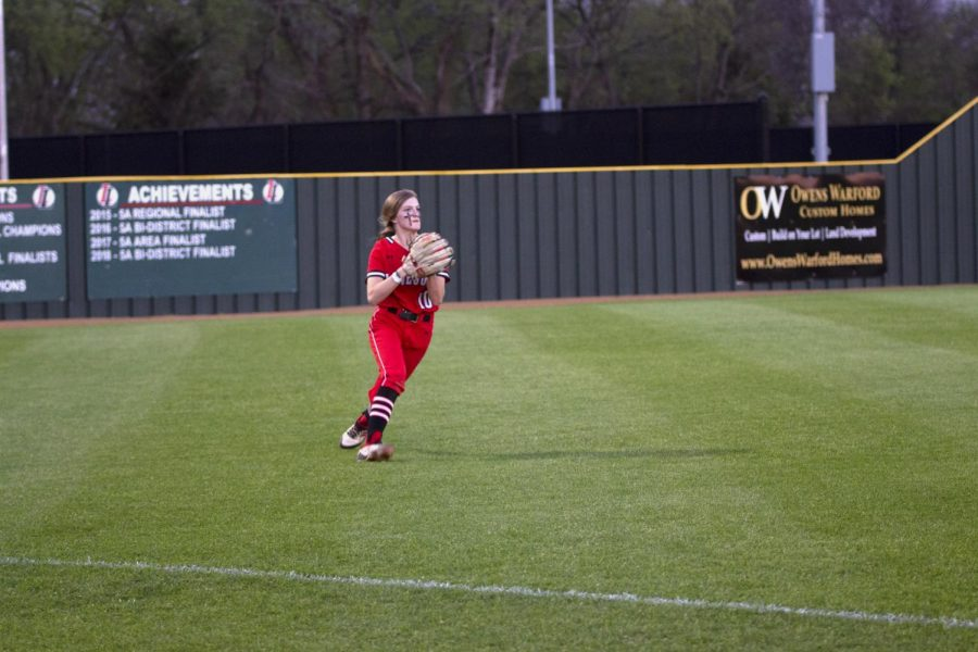 Freshman center fielder no. 10 Kamryn Messick catches a throw from outfield. The score was 2-1 Leopards during this play.