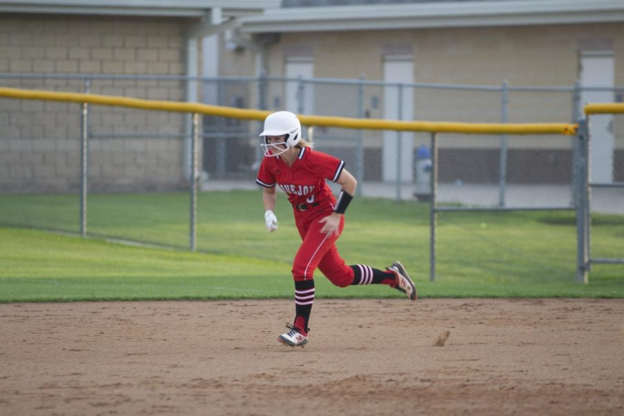 Freshman pitcher no. 5 Skylar Rucker runs to second base. Rucker made one complete run.