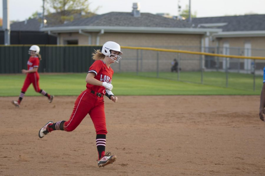Freshman pitcher no. 5 Skylar Rucker runs to third base. The game concluded with a score of 9-5.