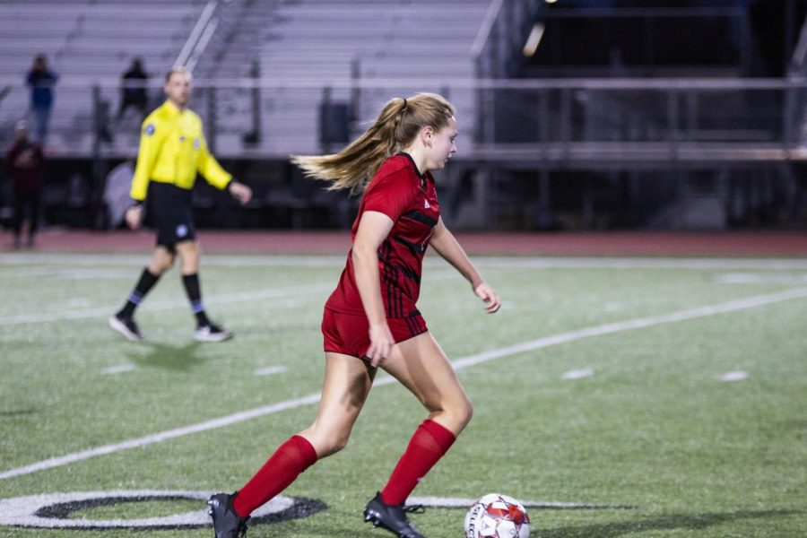 Sophomore defender no. 2 Maggie Manders dribbles the ball. The Leopards are currently ranked second in the district.