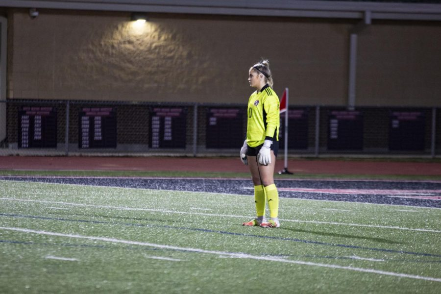 Senior goalkeeper no. 0 Hailey Downing waits for the ball. Downing is the starting goalie for the girl's soccer team.
