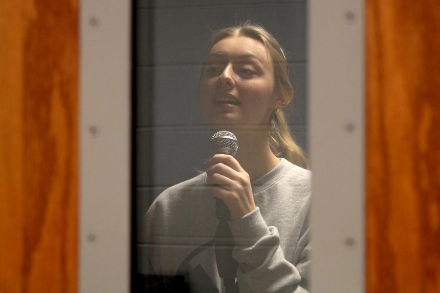 Senior Tessa Blasko stands in a music practice room. Blasko released her first song,