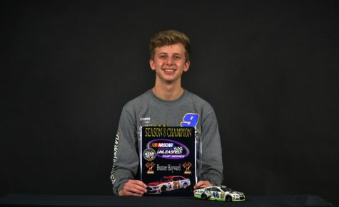 Freshman Hunter Hayward holds his Nascar Diecast championship award. Hayward received a sponsorship from PlanBSales for his virtual racing.