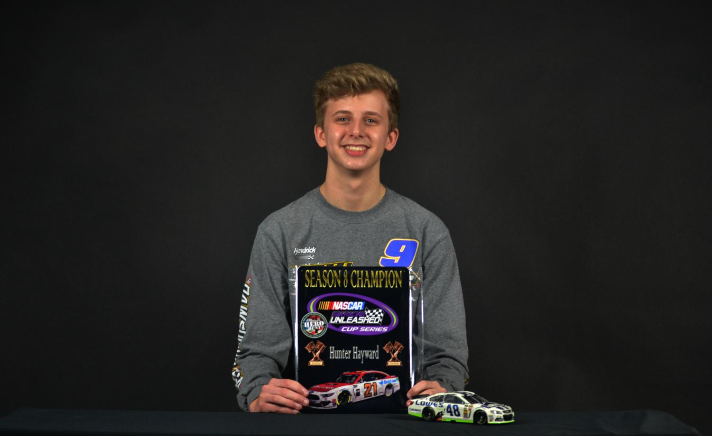 Freshman Hunter Hayward holds his Nascar Diecast championship award. Hayward received a sponsorship from PlanBSales for his virtual racing.