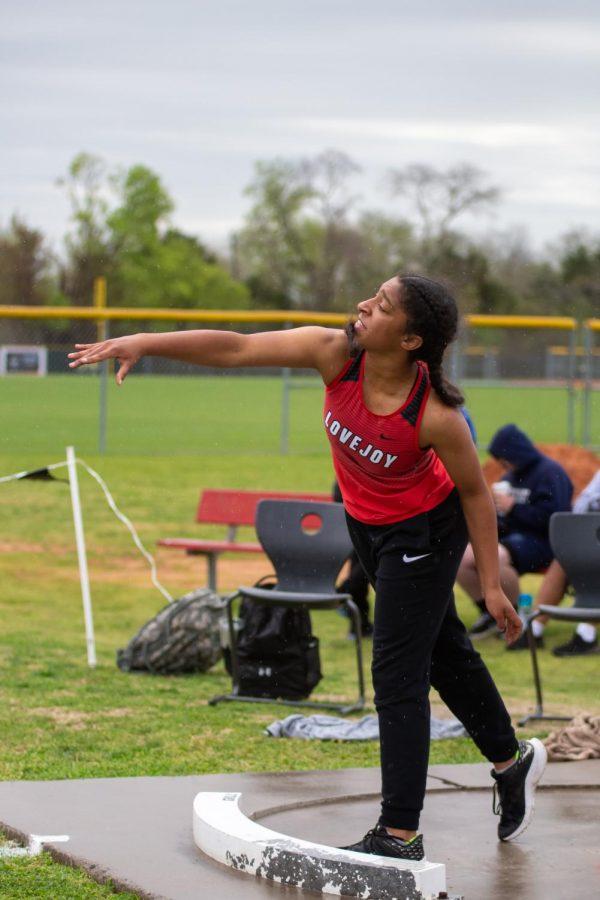 Freshmen shot put thrower Samantha Daniels throws the shot put ball. Daniels threw 23 feet and five and a half inches.