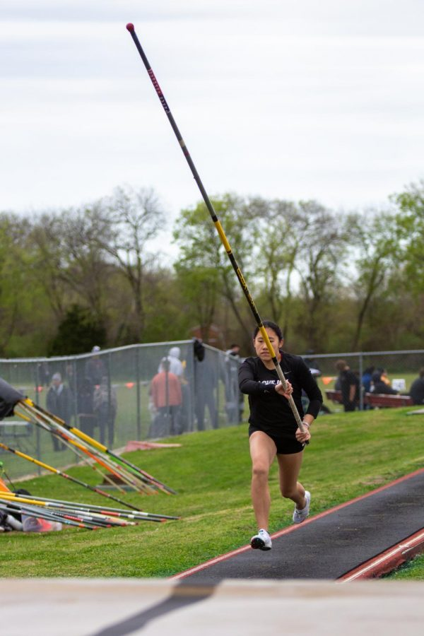 Sophomore pole vaulter Sarah Salsgiver runs with her pole before going over the bar. Salsgiver got third place for the varsity girls competition after clearing 9'3.