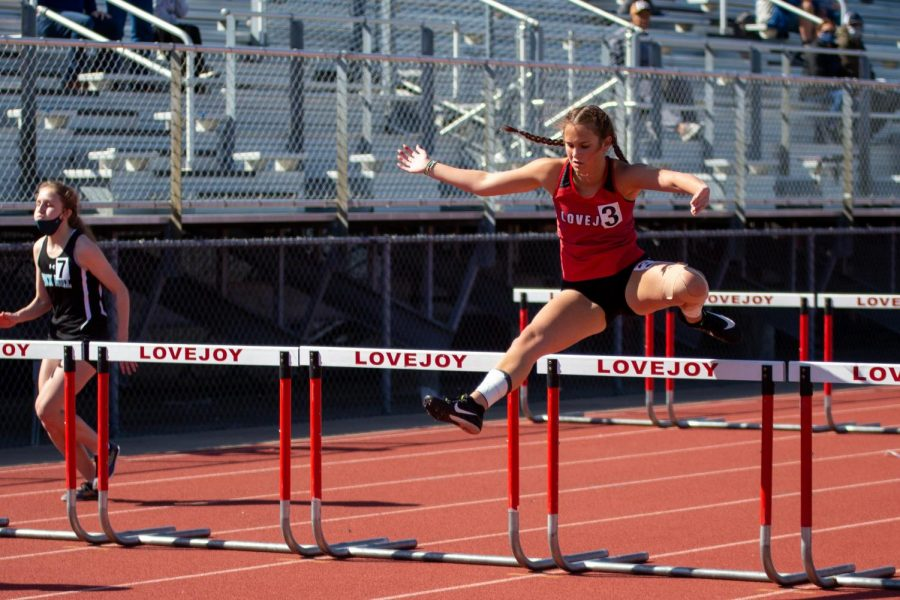Sophomore hurdler Kaitlyn Warren competes in the preliminary 100 meter hurdle event. Warren ran the event in 19.59 seconds.