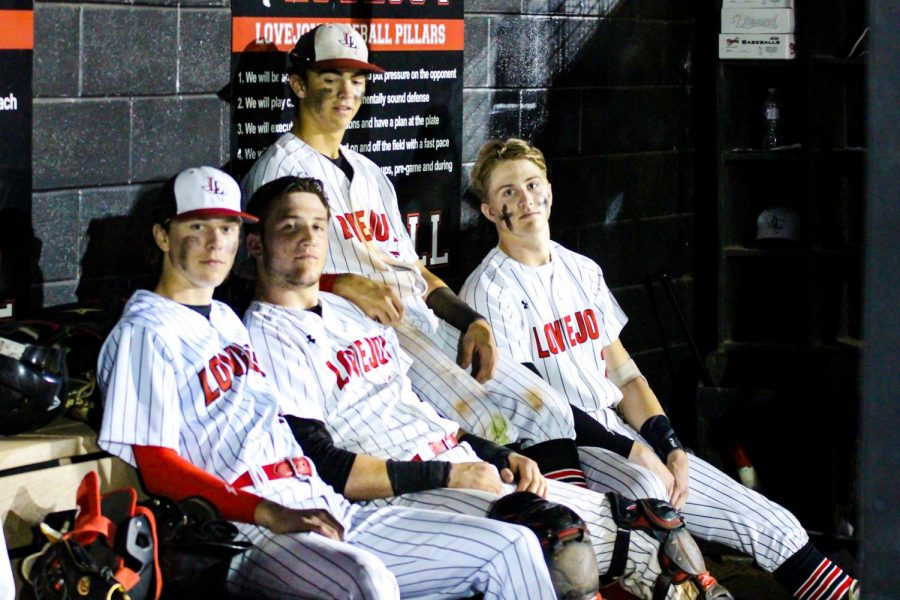 Junior shortstop no. 6 Kolby Branch, senior catcher no. 14 Ralph Rucker, junior left fielder no. 2 Trent Rucker and sophomore center fielder no. 13 Aidan Smith pose for a picture in the dugout during the game. The team is currently second place in district behind The Colony.