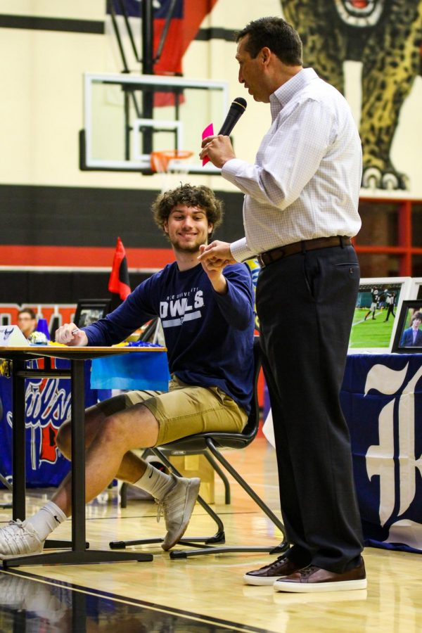 Senior basketball and football player, as well as track runner, Reid Westervelt fistbumps head boys basketball coach Kyle Herrema. Herrema mentioned in his talk that Westervelt has only experienced two losses in his senior year; Aledo in football and South Oak Cliff in basketball.