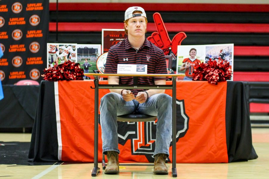 Senior football player and sprinter Chief Collins listens as head boys basketball coach Kyle Herrema talks about senior basketball player Carson Holden. Collins is a first-team all-state safety and will be attending Texas Tech to play football.