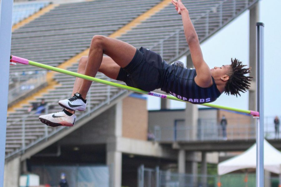"""Junior high jumper Trey Pugh sails over the bar as he clears 5'10"""" on his third attempt. Lovejoy had two high jumpers competing, Pugh and freshman Colston Adamson, neither qualified for state."""