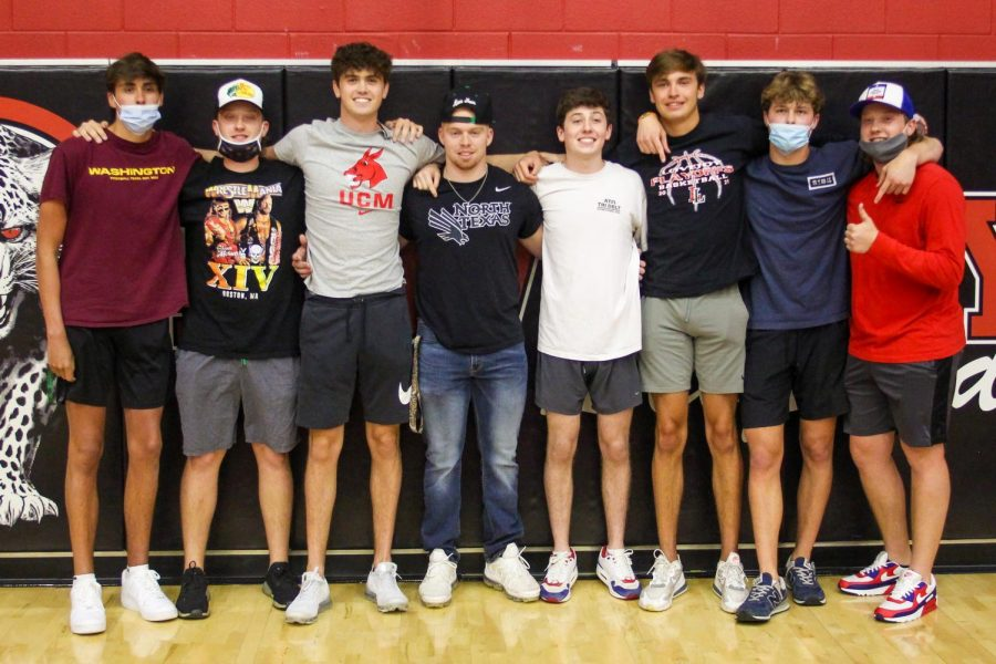 Senior signees Carson Holden and Blake Slaughter pose for a photo with friends Michael Calhoun, Gavin Burkhardt, Brecken Burkhardt, Braden Bahner, Owen Burnette, and Sean Calhoun after the event. Holden signed to play basketball at Central Missouri.
