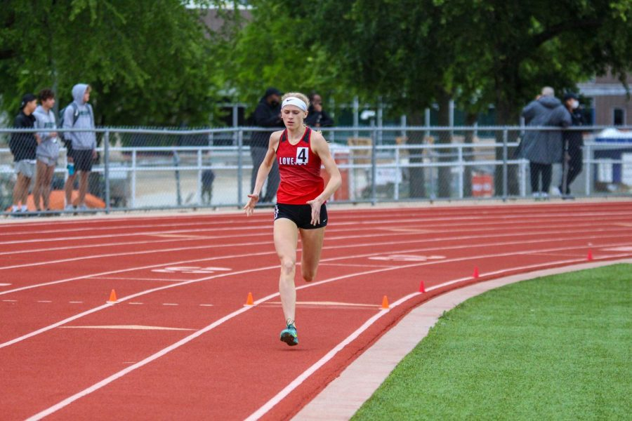Freshman runner Kailey Littlefield begins her last 300 meters of the 1600 meter race. Littlefield overtook Reedy's senior runner Colleen Stegmann in the last 100 meters to take first place.