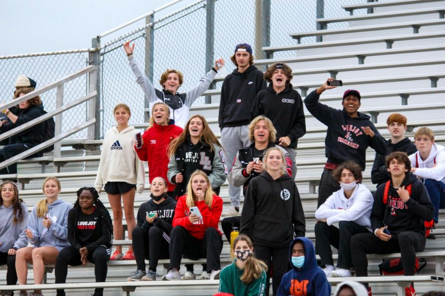 The group of Leopard track runners waiting for their races cheer as freshman runner Kailey Littlefield passes Reedy's senior runner Colleen Stegmann in the 1600 meter race. The regionals meet will be held at the University of Texas in Arlington on April 23-24.