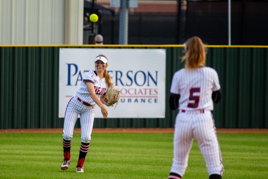 Freshmen outfielder no. 17 Kennadi Deboer throws the ball to freshmen shortstop no. 5 Skylar Rucker. The Leopards only allowed four runs to be scored by Wylie East.