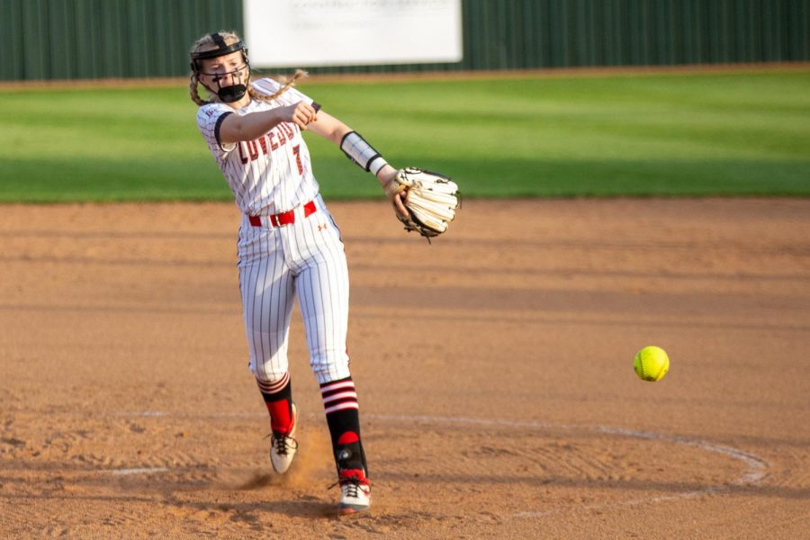 Sophomore pitcher no. 7 Jade Owens pitches the ball to a Raider hitter. Owens pitched the first five innings of the game.