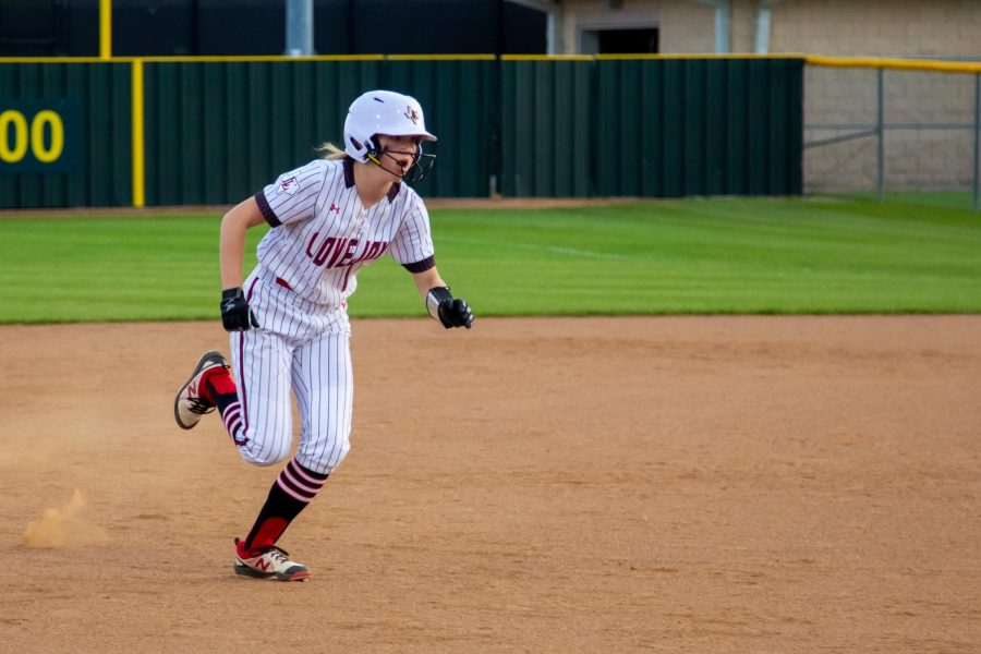 Sophomore second baseman no. 1 Naomi Pierson runs to third base. Pierson scored one run of the game.