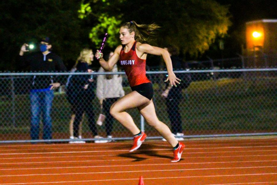 Sophomore Chloe Schaeffer runs as the first leg for the 4x400 meter relay. The team won the race by only 1.04 seconds with McKinney North coming in second.