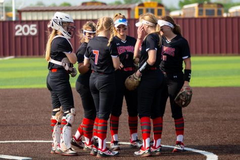 Sophomore catcher no. 3 Sydney Bardwell, junior third basemen no. 16 Emma Bittlestone, sophomore pitcher no. 7 Jade Owens, freshmen short stop no. 5 Skylar Rucker, senior first basemen no. 4 Holly Massey, and sophomore second basemen no. 11 Hannah Harvey stand together before the start of the second inning. The Leopards will play Frisco Wakeland tonight and tomorrow for the first round of playoffs.