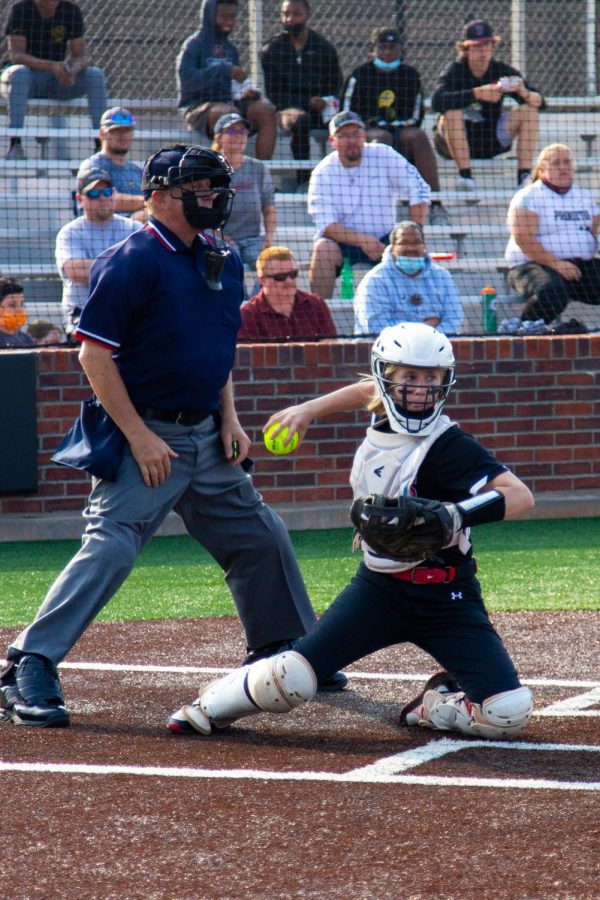 Sophomore catcher no. 3 Sydney Bardwell throws the ball back to sophomore pitcher no. 7 Jade Owens. Bardwell played as catcher all four innings of the game.