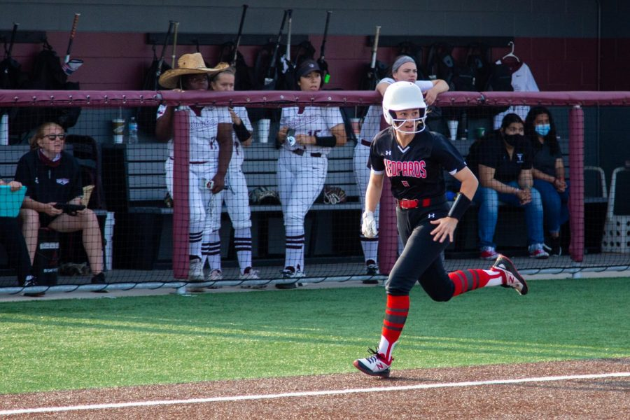 Freshmen short stop no. 5 Skylar Rucker runs from third base to home plate. Rucker scored two runs during the third and fourth innings.