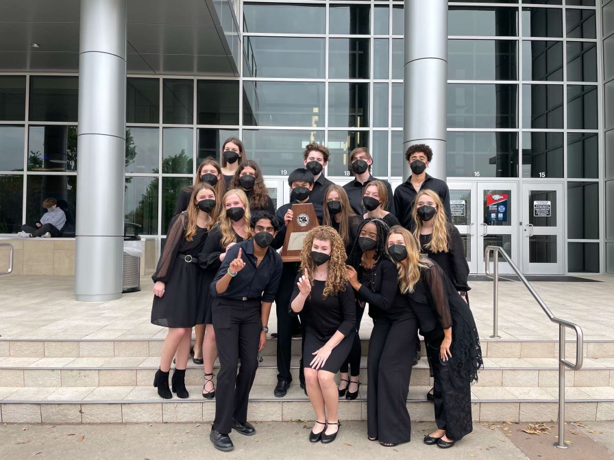 The+senior+choir+members+take+a+picture+with+their+trophy.+Mixed+varsity+scored+all+ones+at+UIL.