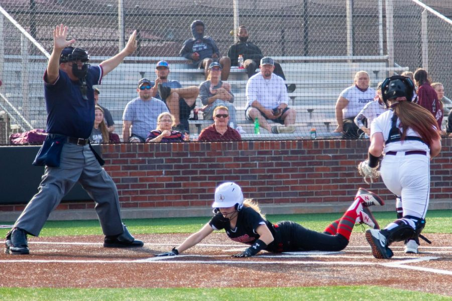 Sophomore second baseman no. 1 Naomi Pierson slides into home base. Pierson scored one run of the game.