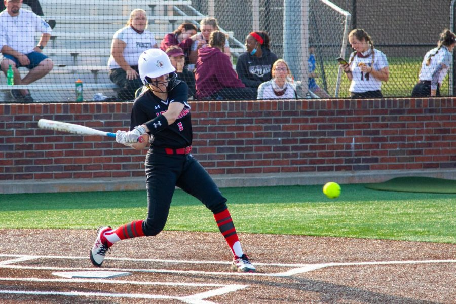 Sophomore catcher no. 3 Sydney Bardwell swings through to hit the ball. Bardwell scored one run in the third inning.