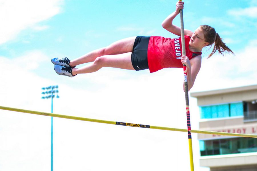 """Freshman pole vaulter Brinley Ludlow flies over the vaulting bar. Ludlow was named JV girl's pole vaulting district champion after clearing 8'1""""."""
