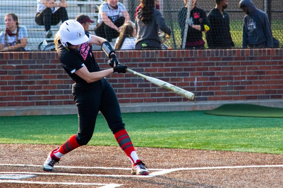 Senior first basemen no. 4 Holly Massey hits the ball. Massey scored two runs during the game.
