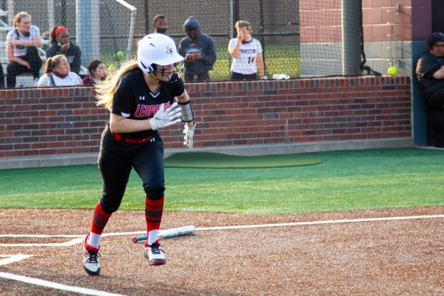 Sophomore catcher no. 3 Sydney Bardwell runs after hitting the ball. Bardwell hit in all four innings.