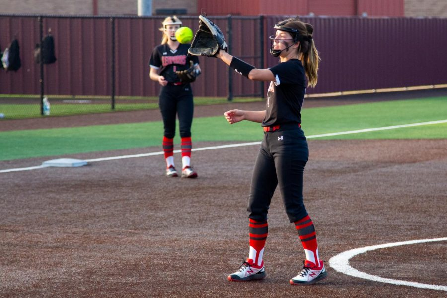 Senior pitcher no. Sydney Provence catches the ball. Sophomore catcher no. 3 Sydney Bardwell threw the ball to Provence.
