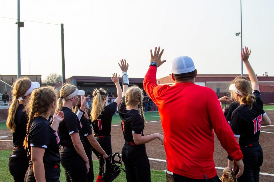 The Leopards wave to the Panthers after the end of the fourth inning. The team will play the Sherman Bearcats tomorrow night.
